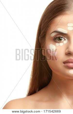 Portrait of beautiful young woman with professional contour and highlight makeup isolated on white