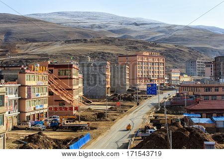 LITANG and GANZI CHINA - MAY 02 2016 : Construction new city at china southwes Tibet under snow mountain Sichuan China