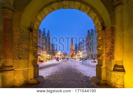 Long lane in the old town of Gdansk in snowy winter, Poland