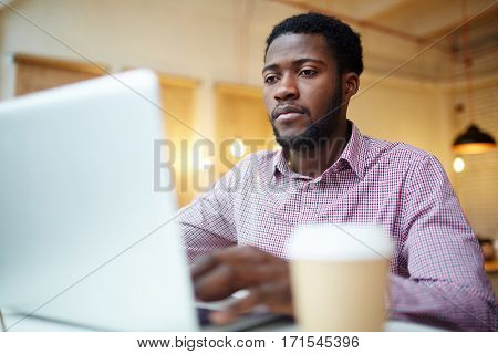 Businessman concentrating on analyzing data or statistics