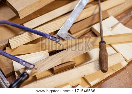 mess of wood and instruments on a carpenter's work place