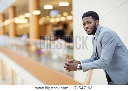 Successful business leader in suit looking at camera
