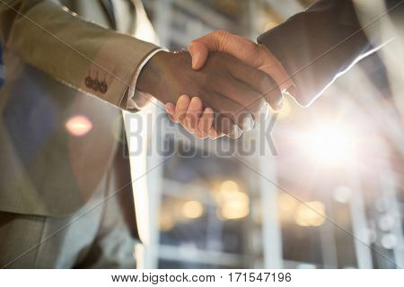 Two human hands handshaking expressing business cooperation