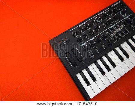 Electronic musical instrument or audio mixer or sound equalizer on a orange background (analog modular synthesizer)