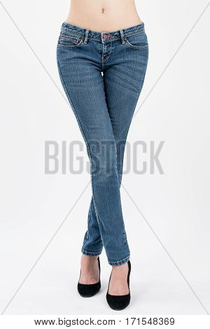 asian women crossing her leg in jeans front viewsisolated on white background.