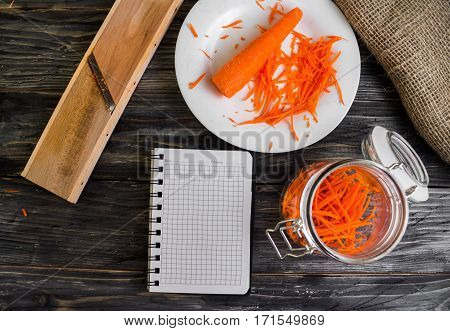 Grated carrot on a wooden background in rustic style