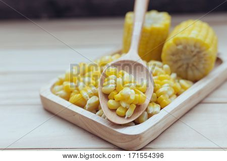 Boiled corn helps nourish the body.background, board, boiled, butter, cereal