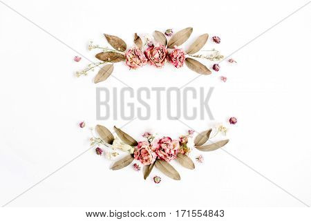 Round frame wreath with roses pink flower buds branches and dried leaves isolated on white background. Flat lay top view. Flower mockup background