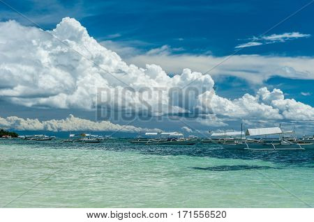 Alona tropical beach with traditional boats at Panglao, Philippines