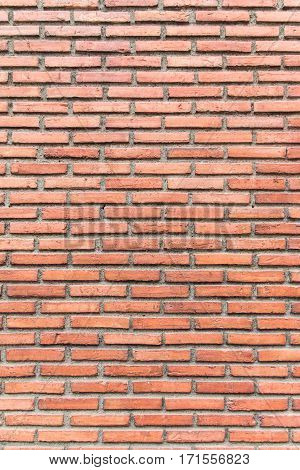 Old red brick wall pattern in vertical