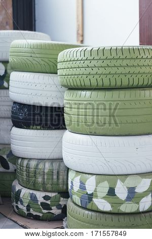 Stacks of car tyres in garage useful as a background