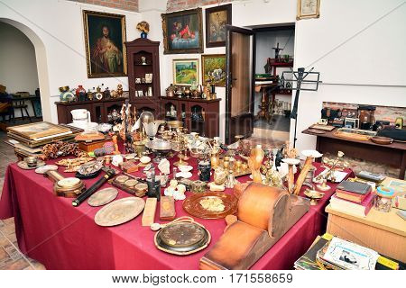Caransebes romania - October 1 2014: objects for sale inside an antique store. Shot taken on October 1st 2014