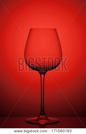 wineglass on red background, close-up studio shoot