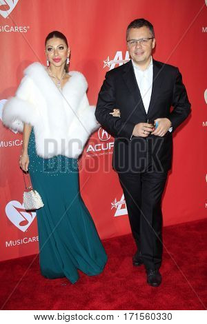 LOS ANGELES - FEB 10:  Irina Vifin, Artur Vifin at the Musicares Person of the Year honoring Tom Petty at Los Angeles Convention Center on February 10, 2017 in Los Angeles, CA
