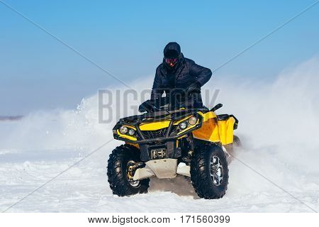 Quad Bike In Motion, Ride On Lake On Snow.