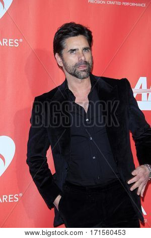 LOS ANGELES - FEB 10:  John Stamos at the Musicares Person of the Year honoring Tom Petty at Los Angeles Convention Center on February 10, 2017 in Los Angeles, CA