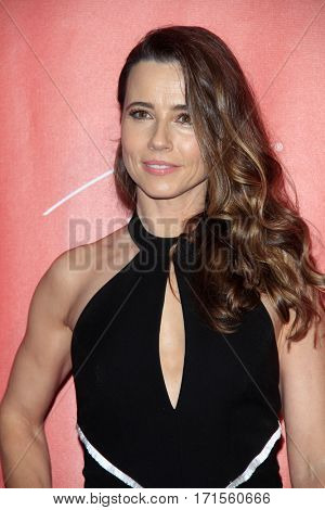 LOS ANGELES - FEB 10:  Linda Cardellini at the Musicares Person of the Year honoring Tom Petty at Los Angeles Convention Center on February 10, 2017 in Los Angeles, CA