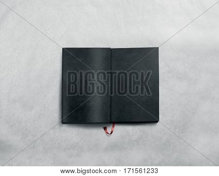 Blank opened book spread mock up with black pages. Reading empty paperback mockup. Grey notebook inside template. Brochure design isolated on textured paper. Textbook spread with bookmark.