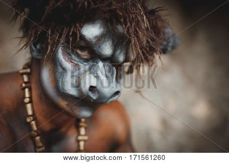 Bodyart Man Angry Minotaur With Axe In Cave. Close-up Portrait