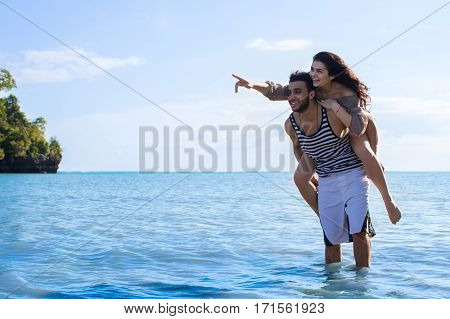 Couple Beach Summer Vacation, Man Carry Woman Point Finger To Copy Space Beautiful Young Happy Man And Woman Smile Sea Ocean Holiday Travel