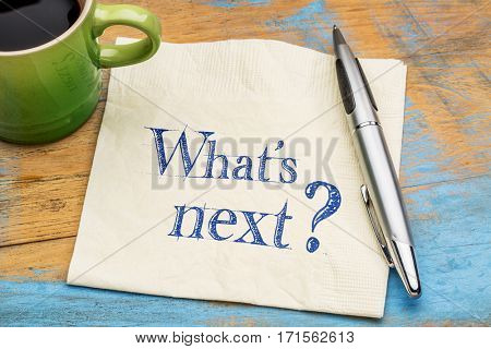 What is next question - handwriting on a napkin with a cup of coffee