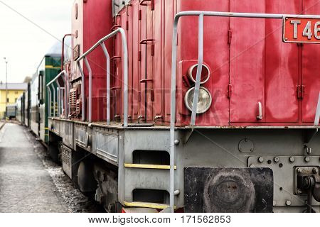 Right hand side of red body of the railway diesel engine