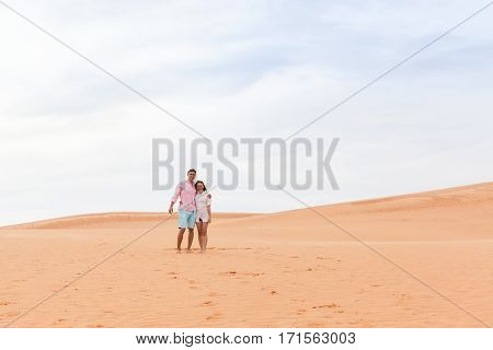 Young Man Woman In Desert Beautiful Couple Asian Girl And Guy Embrace Sand Dune Landscape Background
