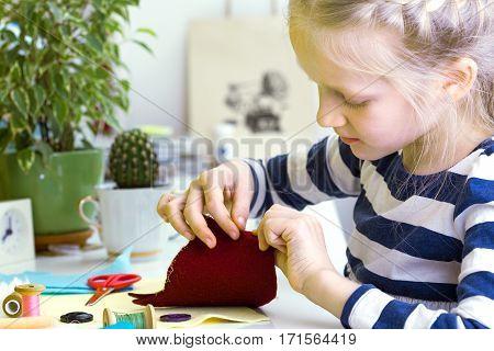 Little Girl Sews Toy