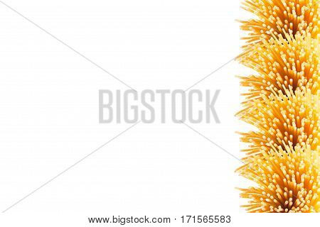 Decorative border of sheaf italian spaghetti with copy space top view isolated on white background. Healthy food.