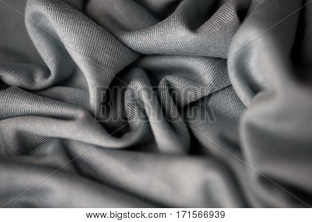 textile and texture concept - close up of crumpled gray cotton fabric background