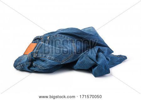 Blue jeans folded on white background