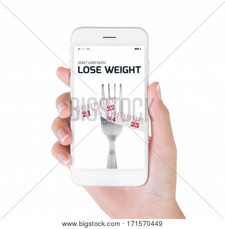 Woman using her smart phone searching lose weight information Measuring tape wrapped on fork in lose weight and diet concept Isolated on white background.