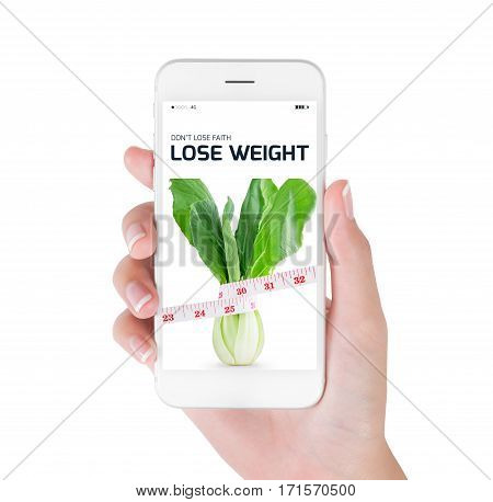 Woman using her smart phone searching lose weight information Measuring tape wrapped on green vegetables and fresh in lose weight and diet concept Isolated on white background.
