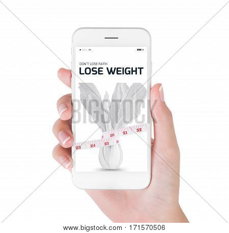 Woman using her smart phone searching lose weight information Measuring tape wrapped on white vegetables in lose weight and diet concept Isolated on white background.