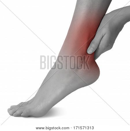 woman hand holding her beautiful healthy foot and massaging ankle in pain area black and white color with red highlighted Isolated on white background.