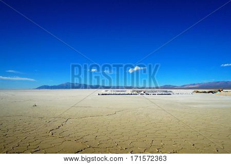 Long shot of the Salinas Grandes salt flats in North Argentina at the foot of the Sierras de Cordoba mountain range in South America