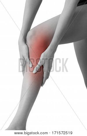 woman holding her beautiful healthy long leg with massaging shin and calf in pain area black and white color with red highlighted Isolated on white background.