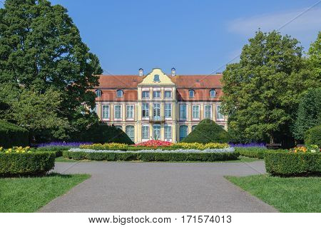 GDANSK - OLIWA, POMERANIAN / POLAND - AUGUST, 2016: Abbots historic palace built in the rococo style located in a beautiful park in Gdansk - Oliwa