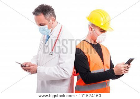 Doctor And Constructor Texting On Their Smartphones