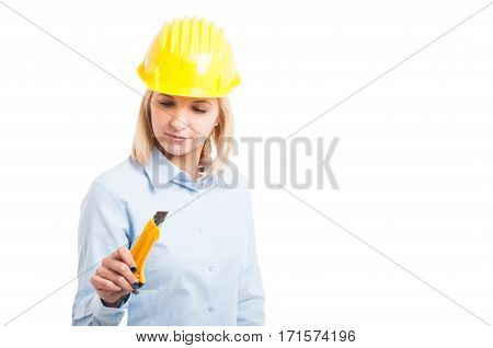 Woman Architect Wearing Yellow Helmet Looking At Cutter