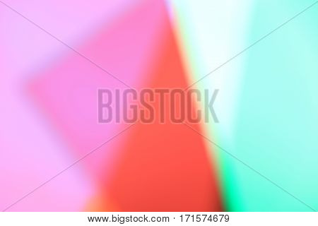 Multicolored blurred surfaces as a Background in red, pink and green