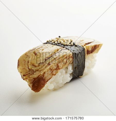 Japanese Sushi - Tamago Nigiri Sushi (Sweet Egg Omelette Sushi) on White Background