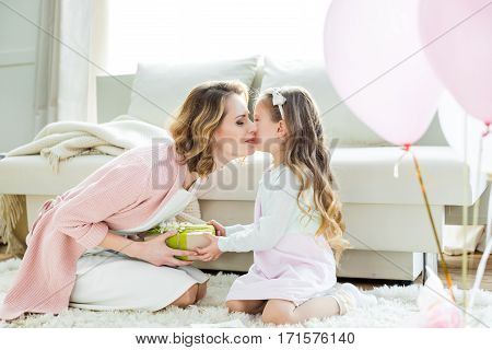 Girl Presenting Gift To Mother