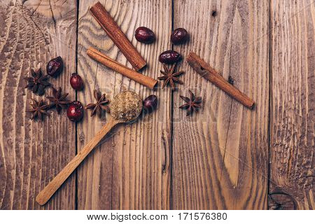 Anise and cinnamon sticks on the wooden background.