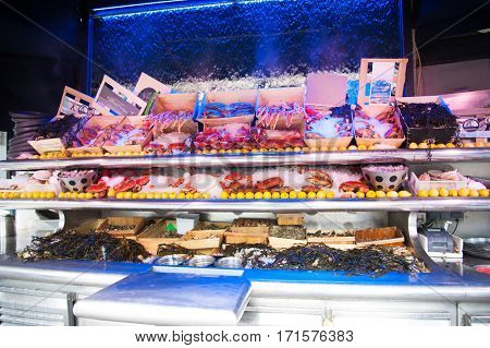 Seafood on ice at the fish market, crabs and clams
