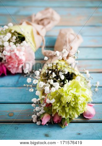 Mini flower bouquet with roses and carnation