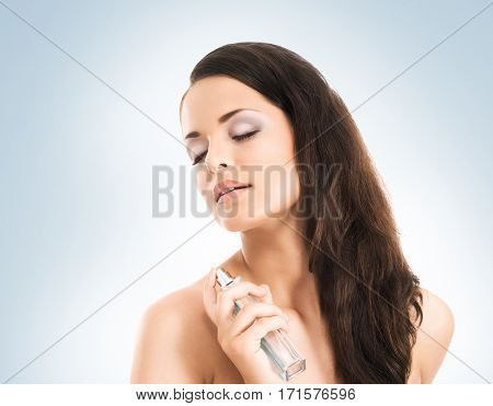 Portrait of young, beautiful and healthy woman over blue background. Healthcare, spa, makeup and face lifting concept.