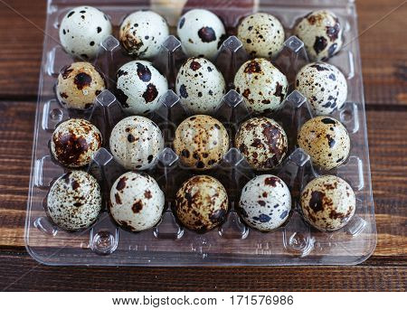 Great packaging quail eggs. The concept of healthy eating and vegetarianism.