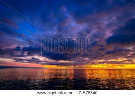 Colorful dramatic sunset view above Glenelg Beach viewed from jetty South Australia