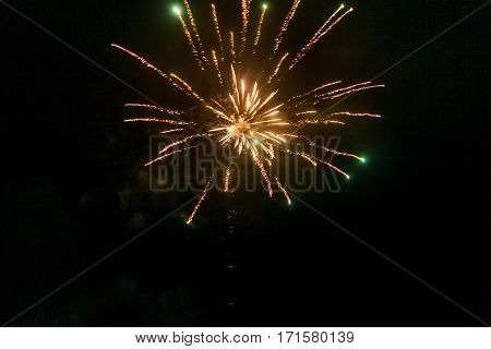 Yellow And Green Fireworks Flash In The Night Sky